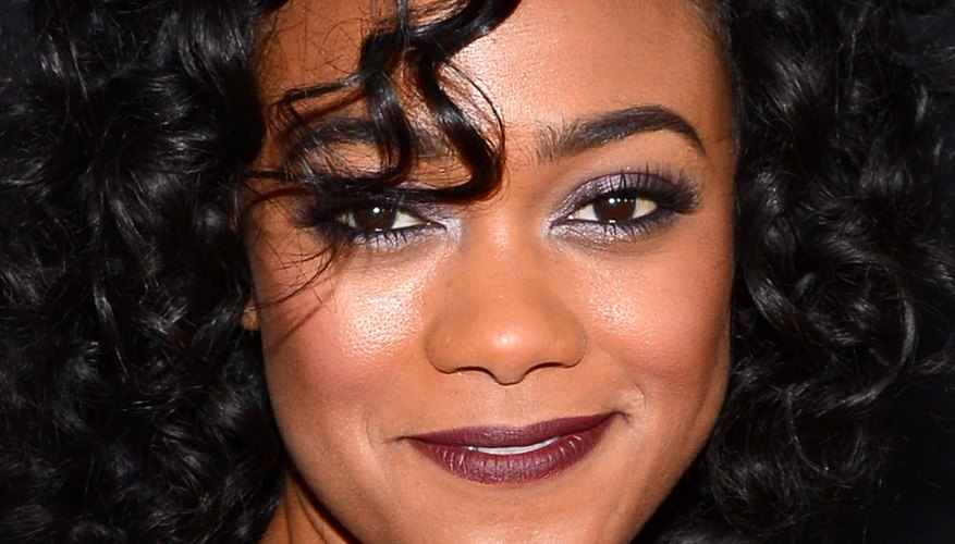 Tatyana Ali shows off her curls with some flirty bangs.