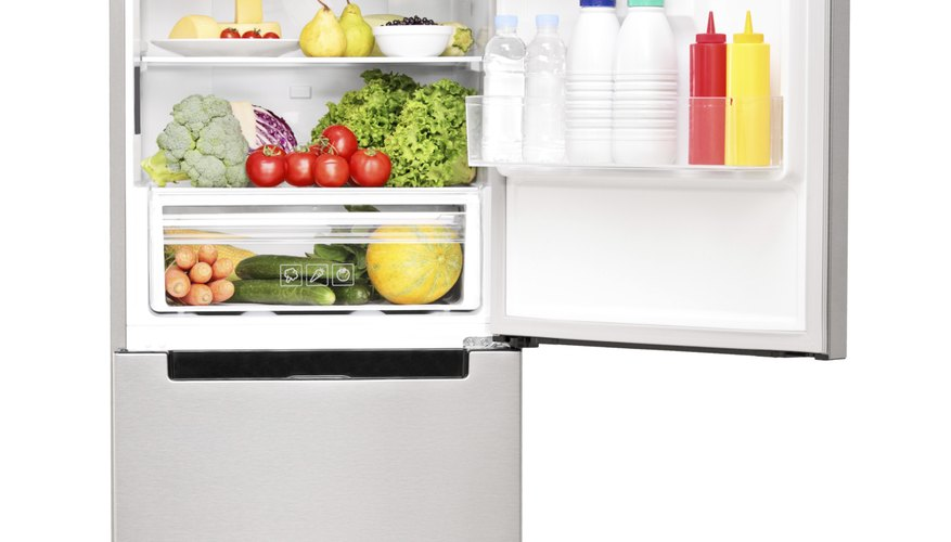 The thermostat is commonly located inside the upper rear of the refrigerator compartment.