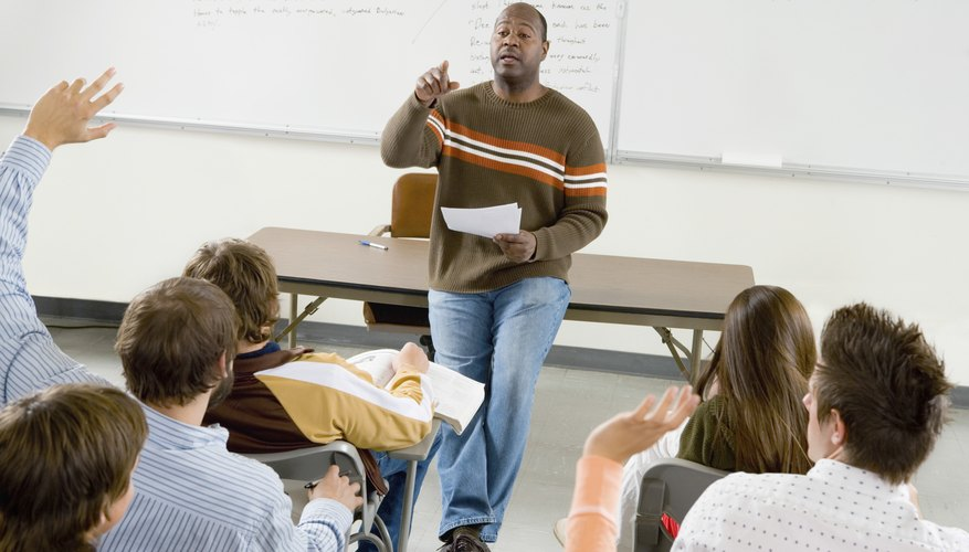 Professor giving lecture in college classroom.