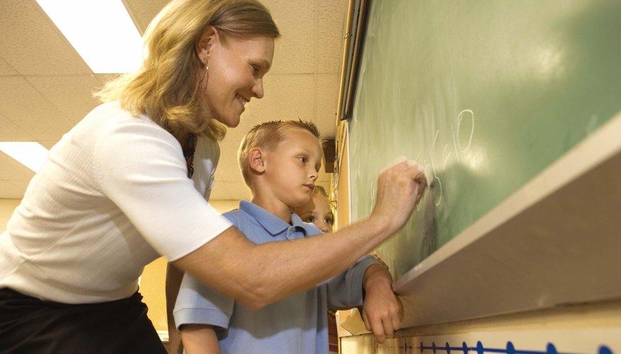 Teacher using chalkboard