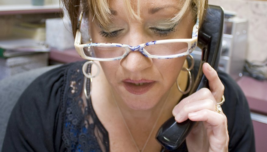 A receptionist books an appointement by phone at a salon.