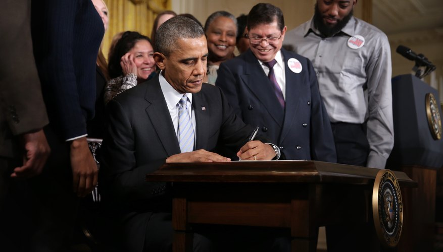 President Obama signing an executive order
