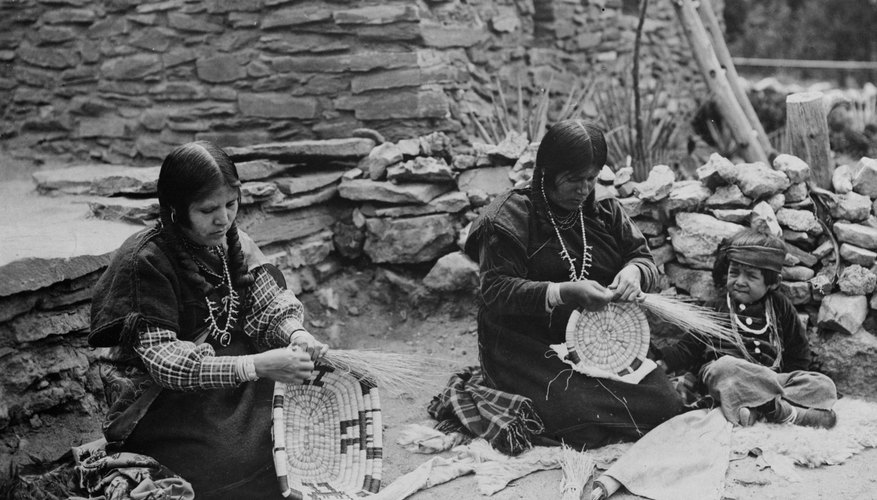 Two Hopis in a Nevada village weave baskets in 1937