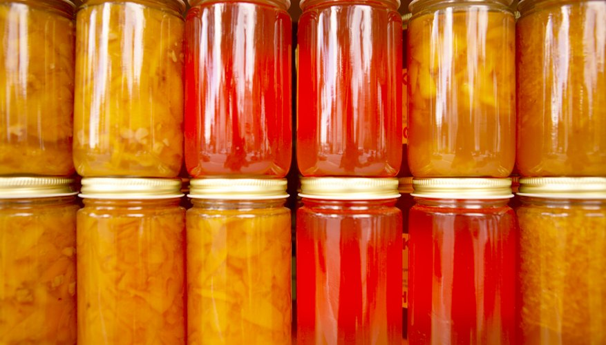 Canning your own goods saves money and builds up storage.