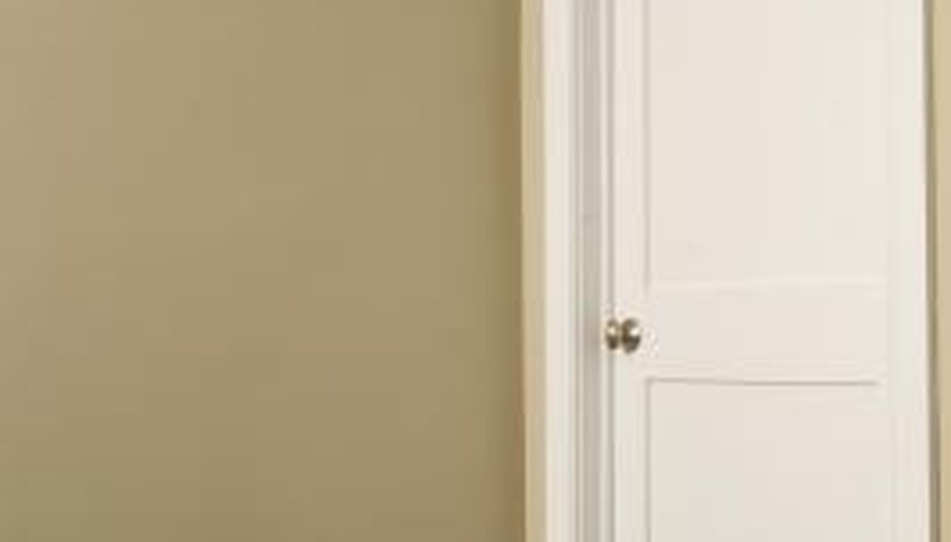 A painted door may stick to a door frame for many reasons.