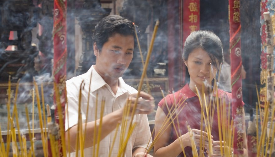 Offerings of incense, candles and flowers are made during the wedding ceremony.