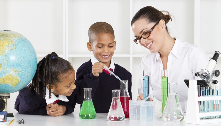 Young students are working with test tubes in their science class.