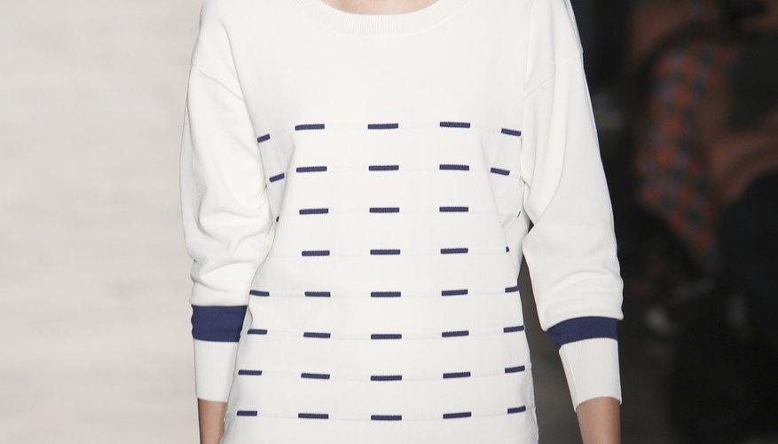 A model walking the runway in a Timeo Weiland show wears a classic drop-waist dress