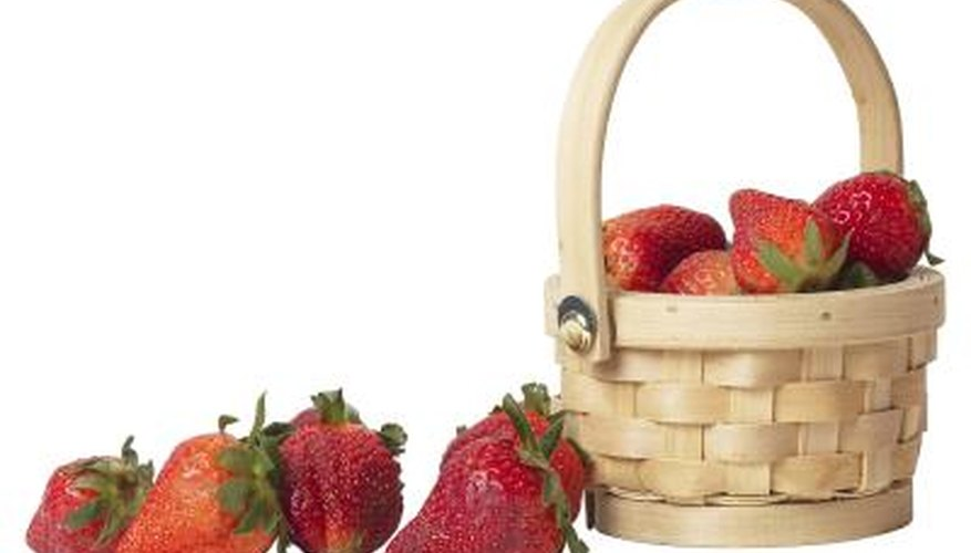 Decorate your home with papier-mache strawberries in a basket.