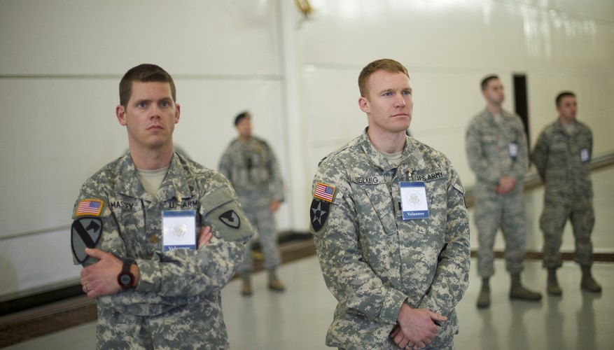 U.S. soldiers standing in waiting room.