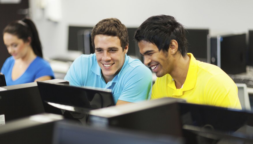 Students smiling in computer lab