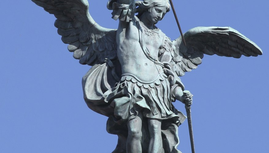 St. Michael Archangel statue on top of St. Angel castle in Rome.