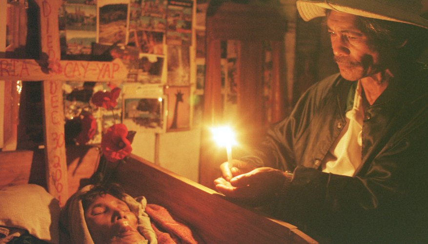 An Ifugao man mourns the dead during a customary three-day wake.