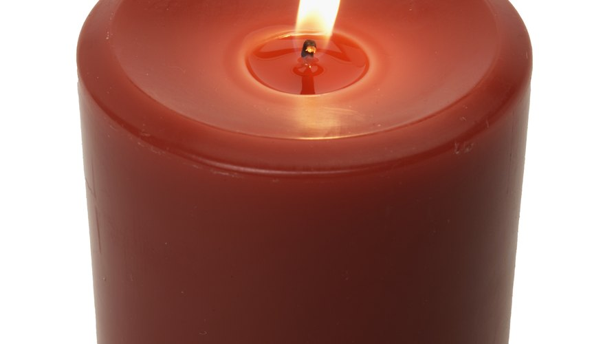 A red candle is often placed on the altar during Catholic mass.