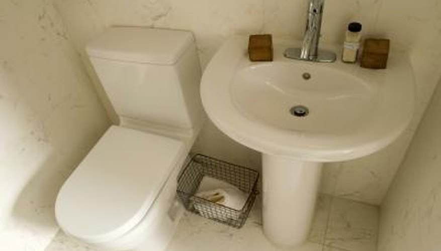 Clean the inside of your toilet tank to avoid unwanted bathroom smells.
