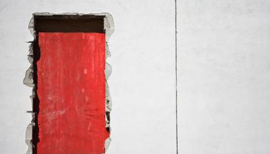 Fill in cracks with insulating foam and then paint it.