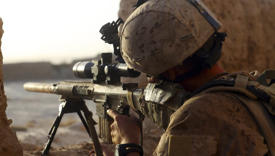 Recon Marine looking through a scope