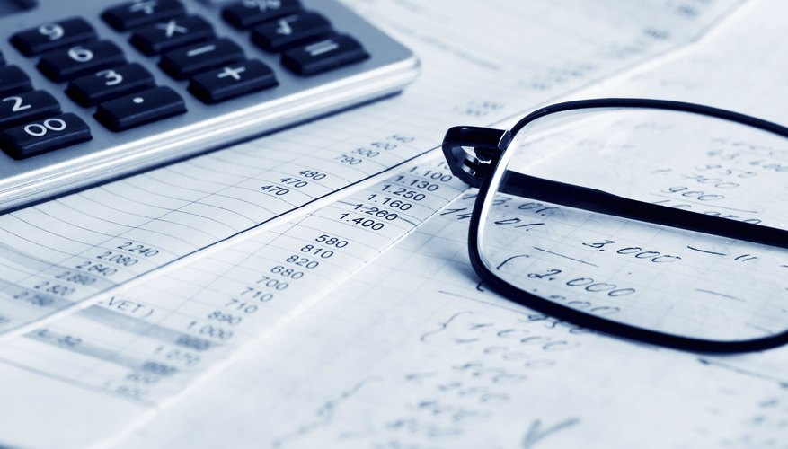 Close-up of accounting paperwork and glasses