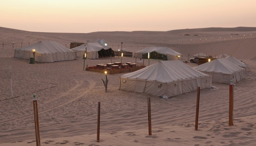 Pillows in solid colours and lush fabrics are the finishing touch to an Arabian tent.