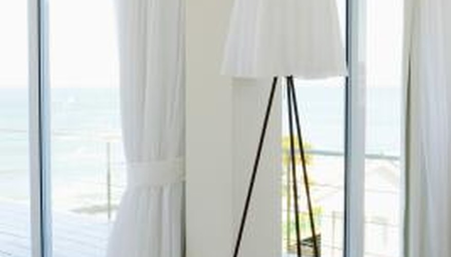 One-directional traverse rods can easily pull curtains out of the way of large windows or patio doors.