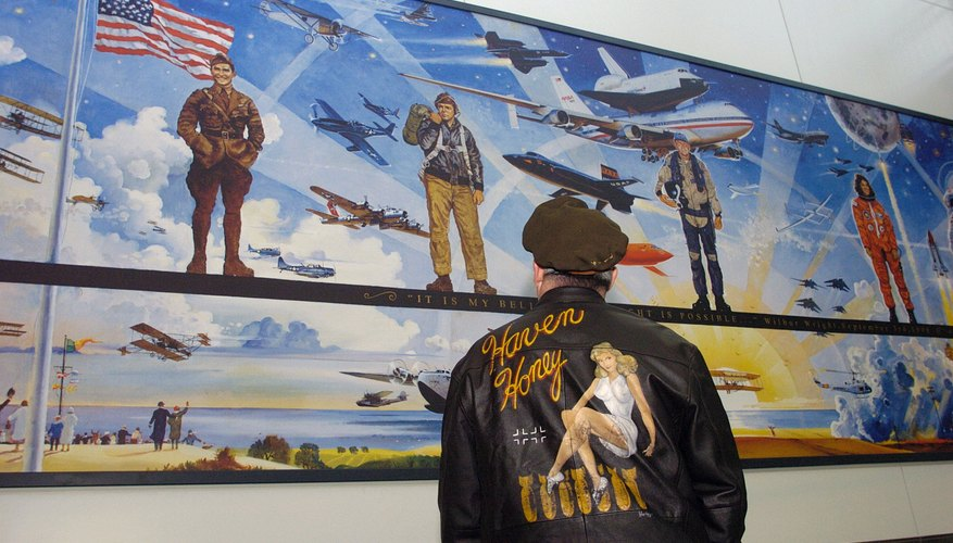 Man admires giant mural about the birth of flight