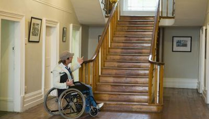 Bring the wheelchair up the stairs.