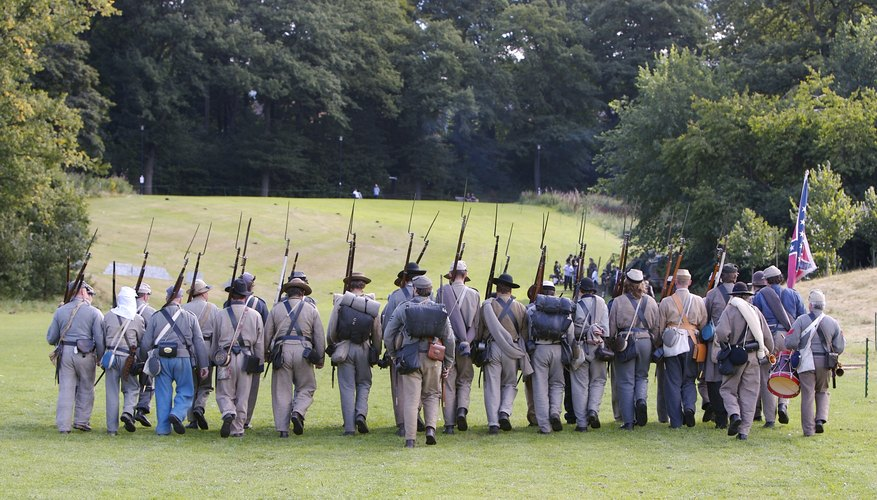 Recreation of civil war soldiers marching with bayonets.