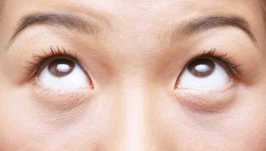 Lightening tattooed eyebrows gives a more natural result.