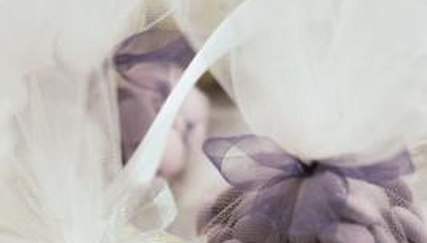 Tulle looks attractive wrapped around small, colourful wedding gifts.