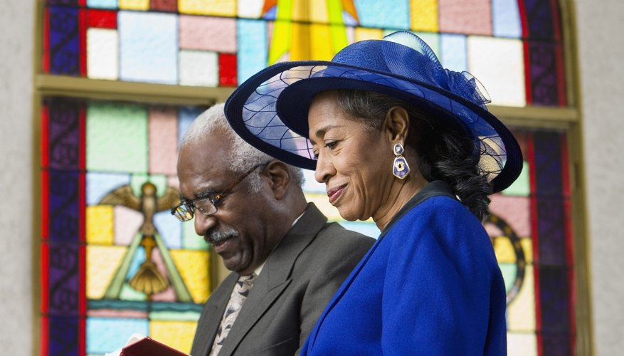 Couple reading Bible in church