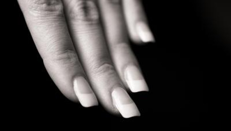 Removing glue-on nails can be done without damaging your nails, if you are careful.