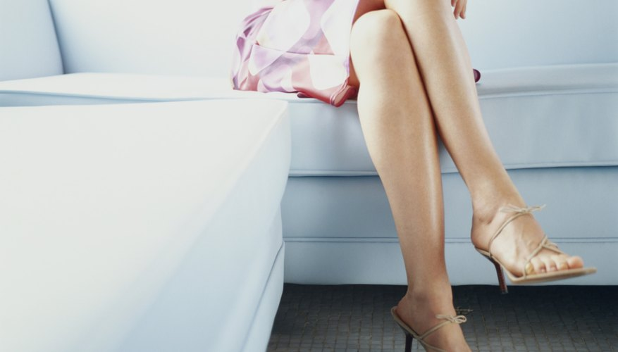 A bit of foundation and some stratigic concealing will give your legs an airbrushed look.
