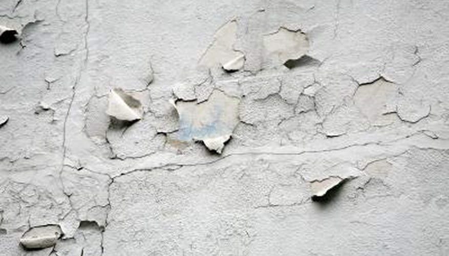 Where emulsion is flaking off plaster, you can remove it with steam and a scraper.