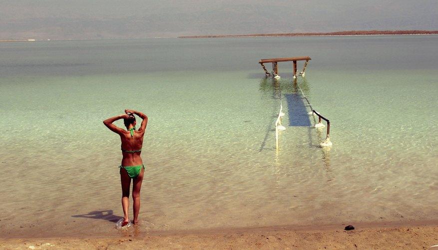 Woman walks toward the Dead Sea for a swim