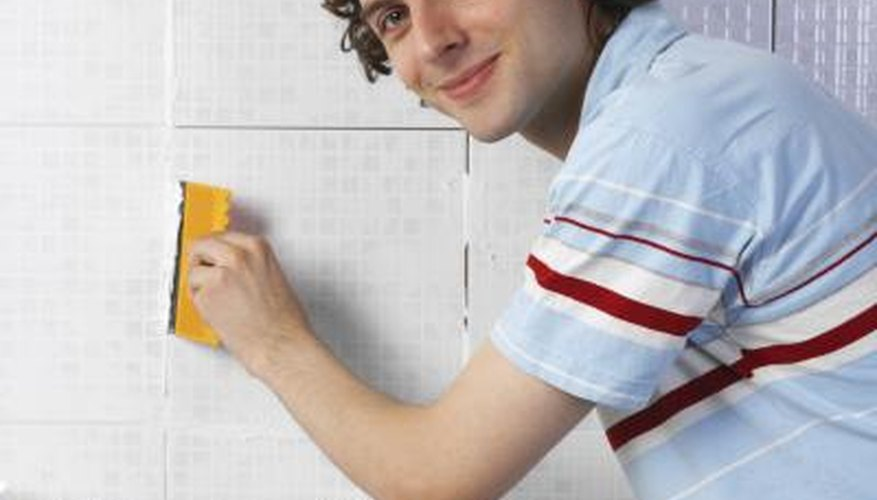 The process of applying grout can leave some on the surface of the tile.