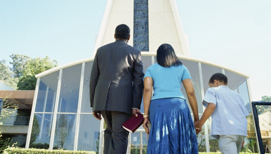 Ushers sometimes welcome members as they enter the church.
