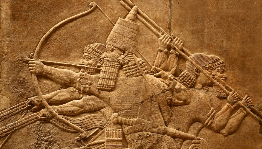 A relief sculpture of ancient Assyrian art depicting battle.