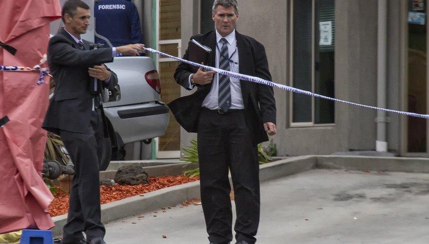 Homicide officer walking towards a crime scene.