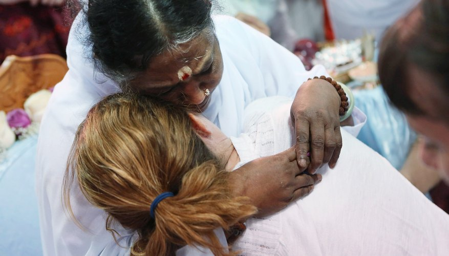 Mata Amritanandamayi gives unusual hugging darshans to her devotees.
