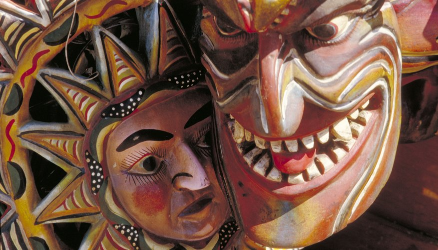 A close-up of two Mexican masks.