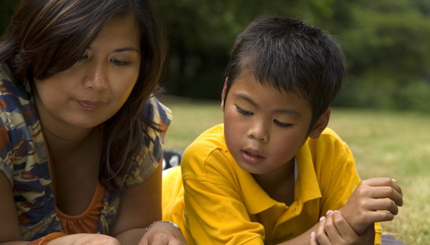 One-on-one reading time with a teacher or parent helps support a young child's reading progress.