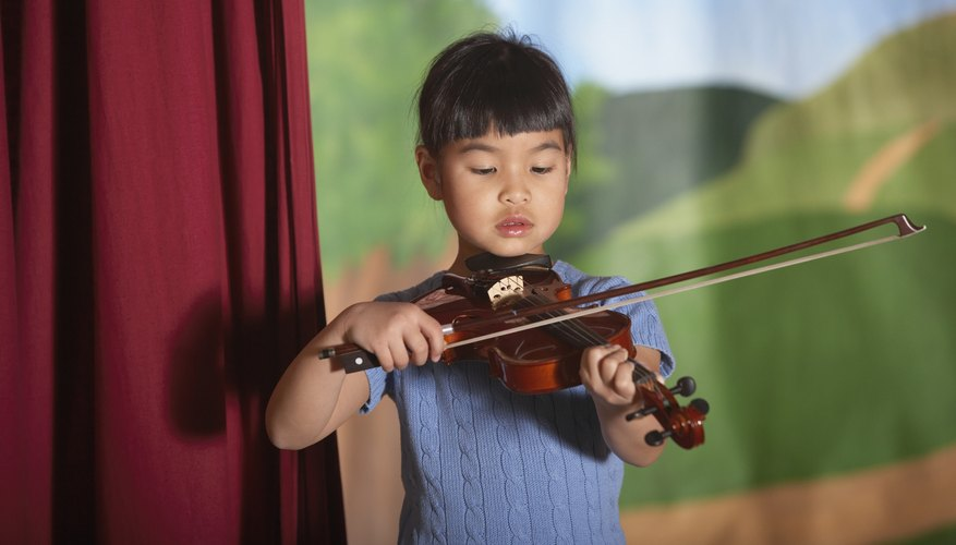 Young child playing the violin.