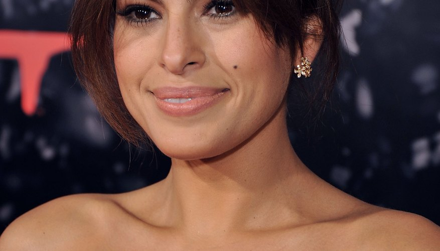 Eva Mendes sports hump hair at a red carpet event in Los Angeles.