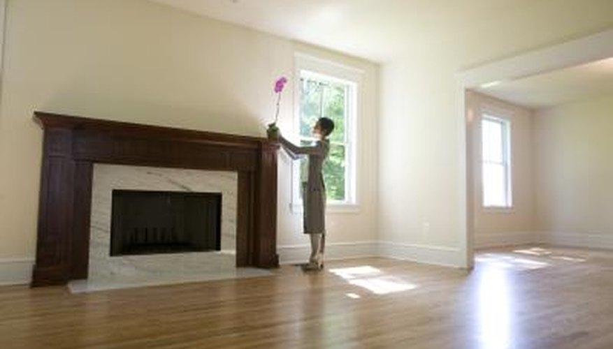 Veneer fireplaces cannot be stained, but brown paint can create the appearance of dark wood.