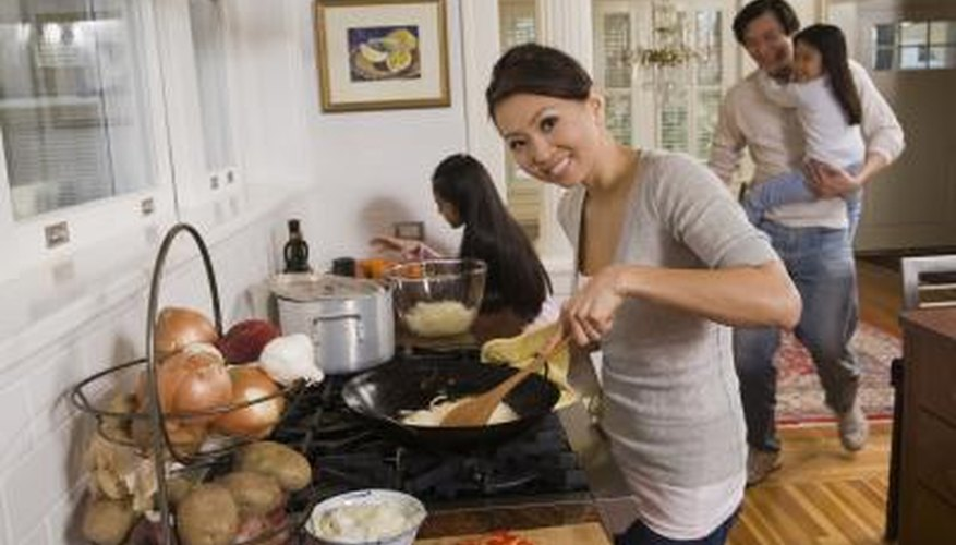 A family gathers in the kitchen for stir-fry.