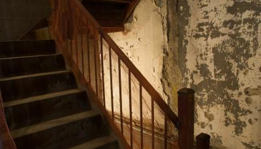Clean old banisters with a solution that will clean and condition the wood.