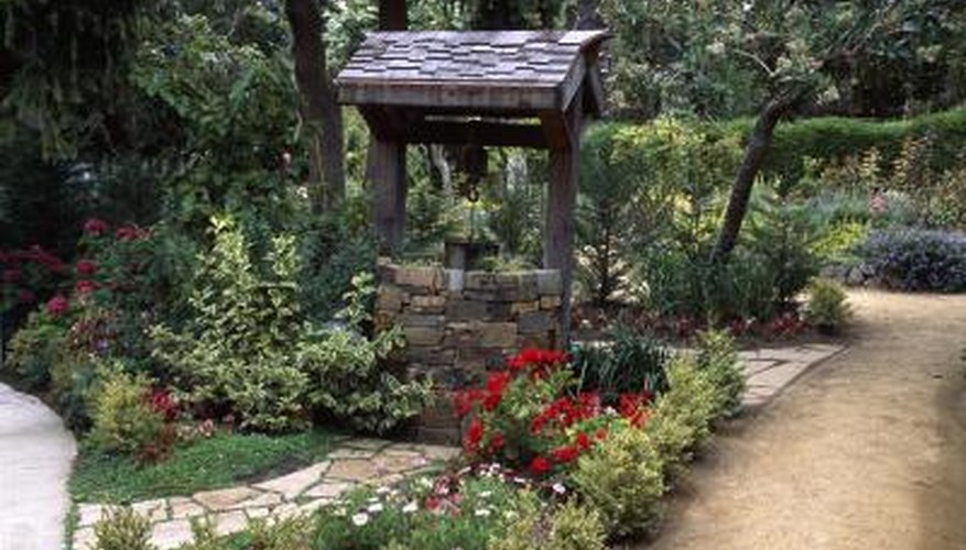 Convert an attractive garden well into a raised plant bed.