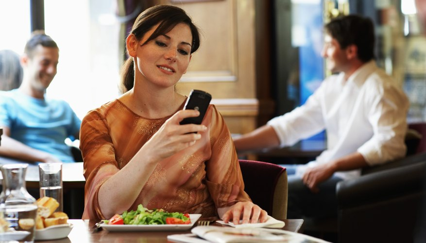 woman reading text message from date