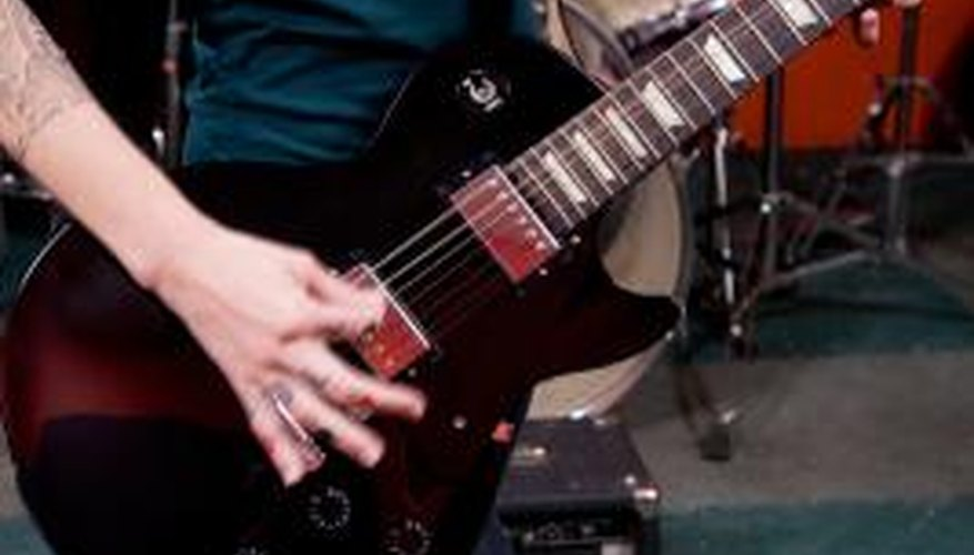 The Epiphone SG and Les Paul utilise the same kind of bridge for easy string changes.