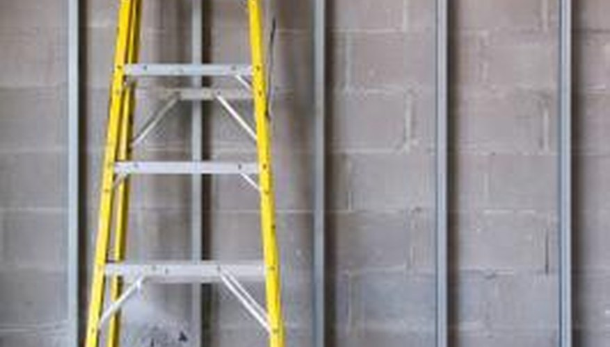 Furring strips create the framework for attaching MDF panels to blocks or concrete.
